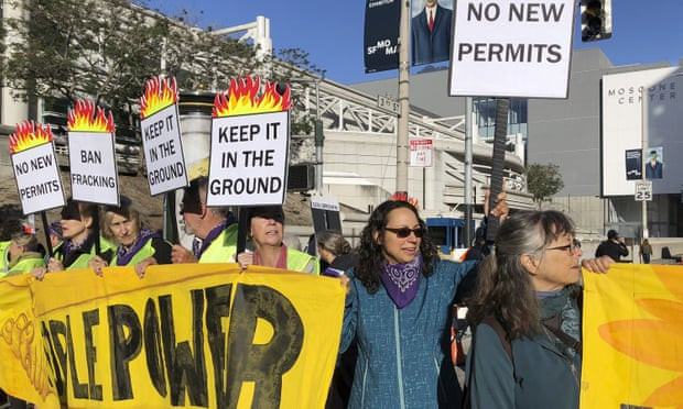 Thousands of protesters challenge Democratic governor at climate summit - Read More from The Guardian