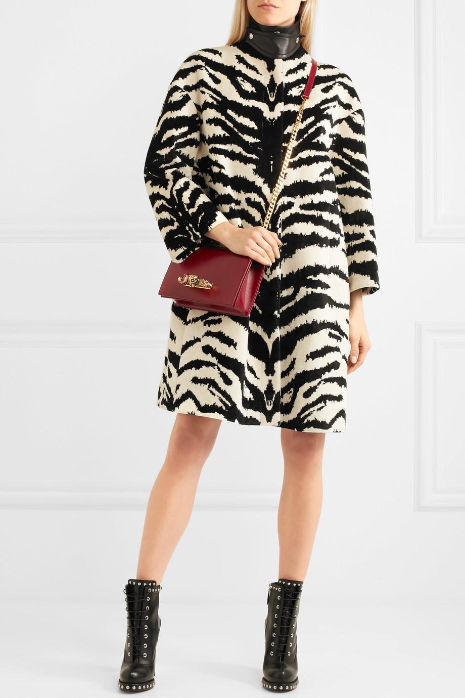 Alexander McQueen Leather-trimmed zebra-jacquard coat $3,695