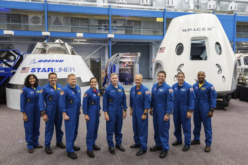 NASA assigns astronauts to SpaceX, Boeing test flights - Read More from Associated Press