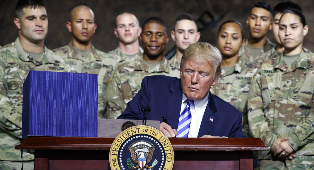 Trump touts military buildup at Fort Drum bill signing - Read More from Politico