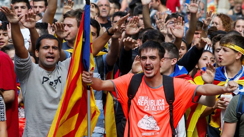 Catalan protests: Tens of thousands mark vote anniversary - Read More from BBC News