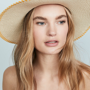 Wearing A Sunhat, Straw Hat, Panama Hat, Raffia Hat Or A Visor While On Holiday & During The Sum