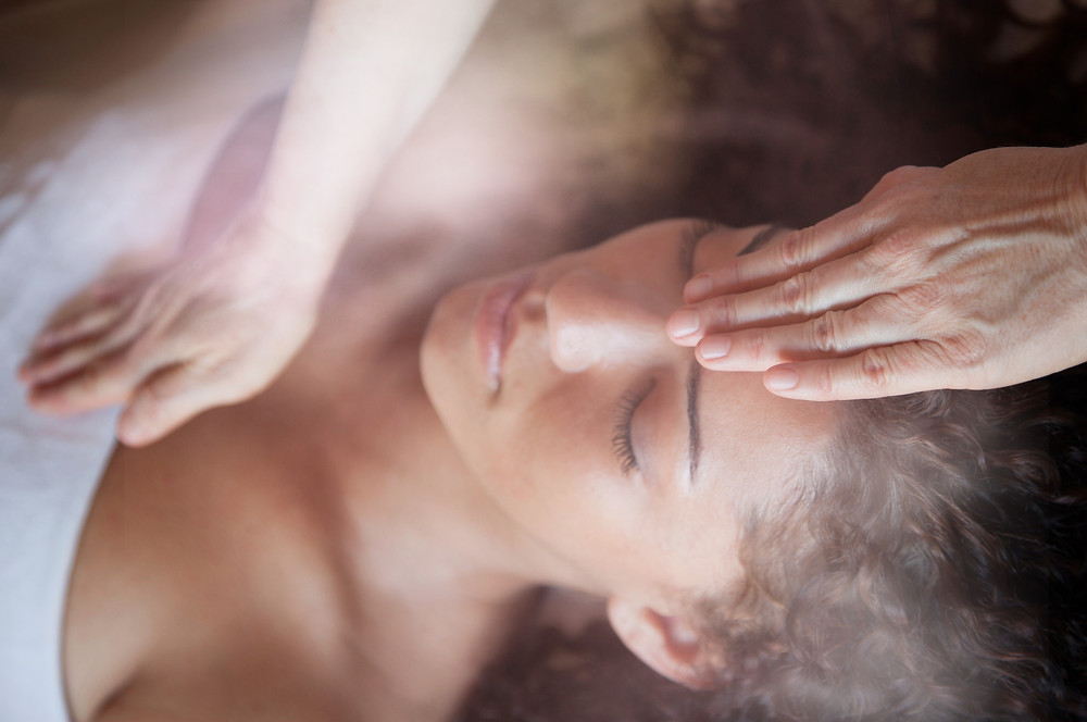 hand on head hand on heart reiki treatment energy work