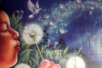 mural at healing connections wellness centre of young girl blowing dandelion, butterflies, bird