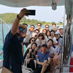 customer selfie on rear yacht deck patta