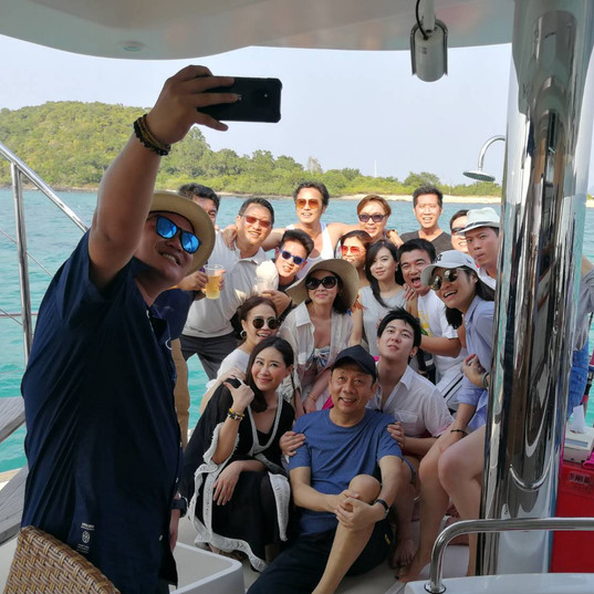 customer selfie on rear yacht deck patta