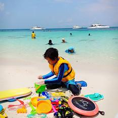 child playing sand at koh pai island.jpg