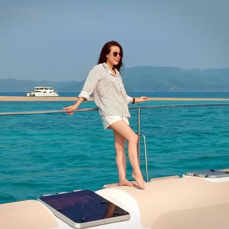 customer posing on yacht trampoline at p