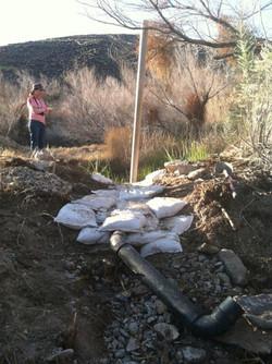 stabilizing original breach in dam