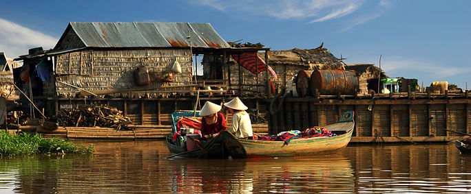 Cambodian women sail on a boat.jpg