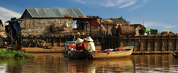 Cambodian women sail on a boat.jpg