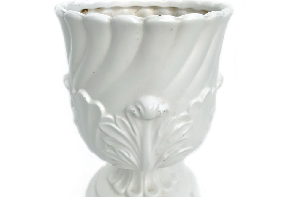 A beautiful traditional style white porceline vase to be filled with succulents