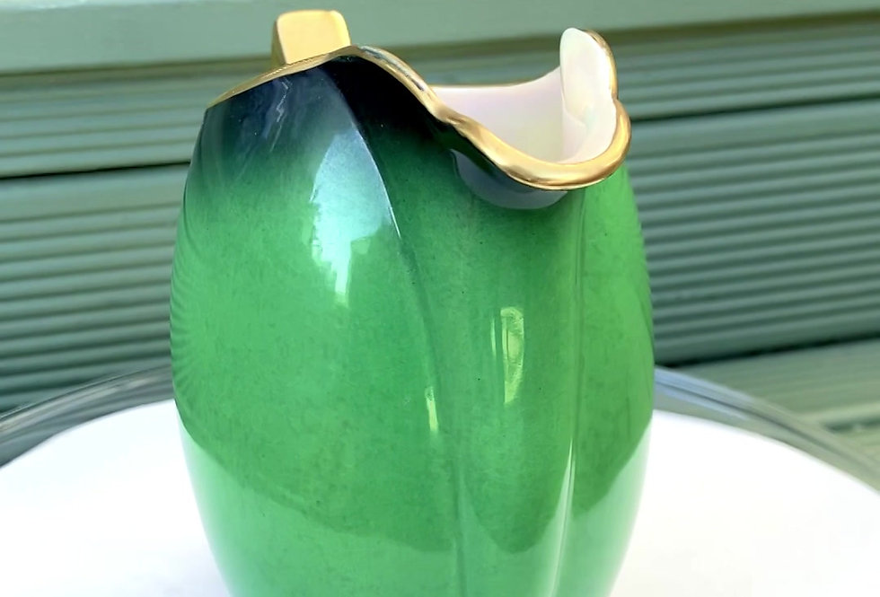 A gorgeous green vintage 'Carlton ware' jug that will be potted with succulents