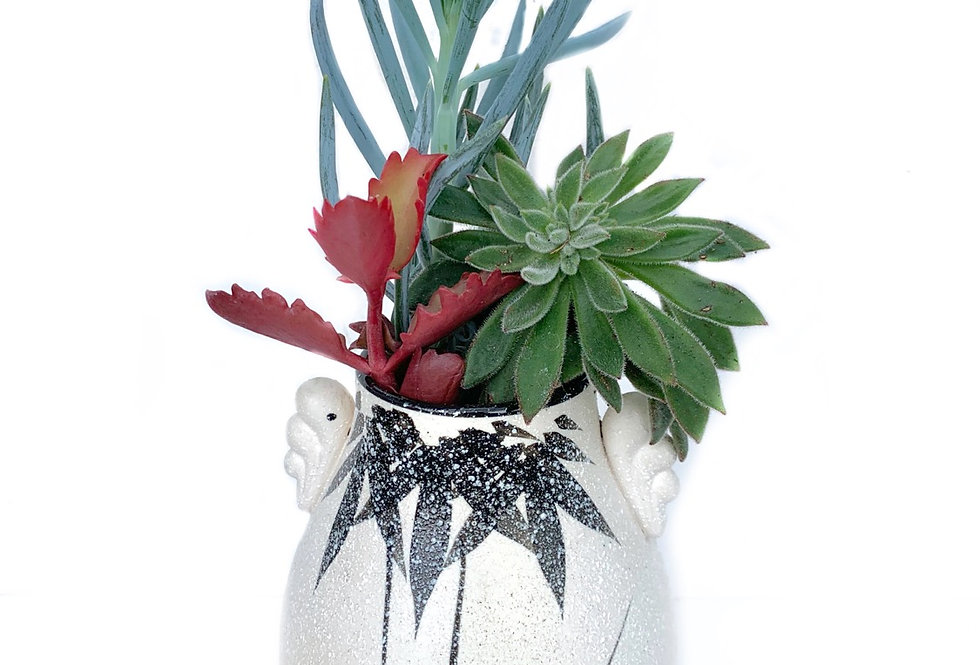 A gorgeous bamboo design vase with succulents