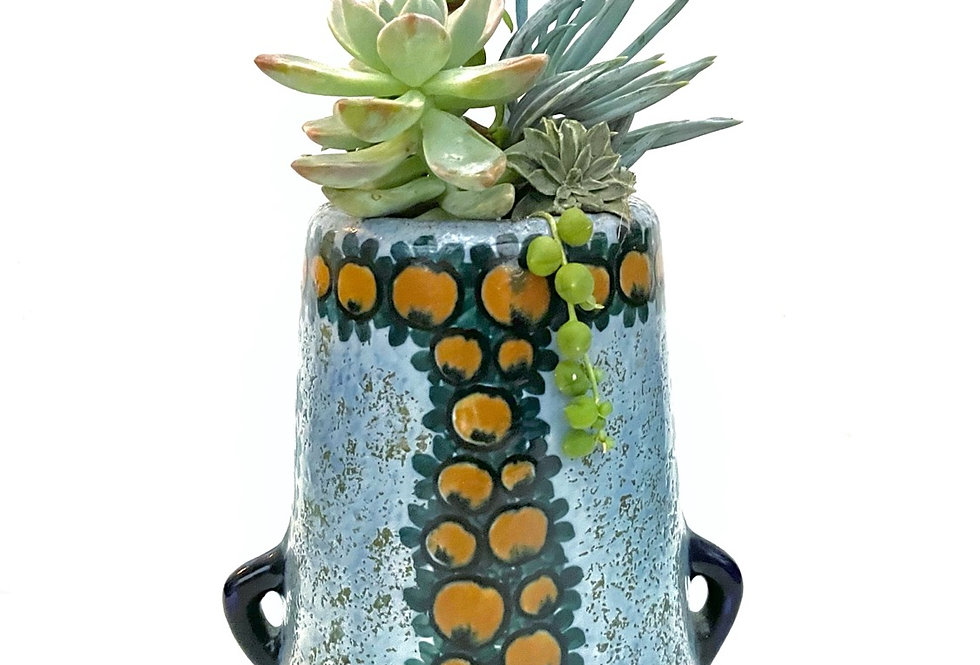 A lovely large decorative vintage vase full with colourful succulents