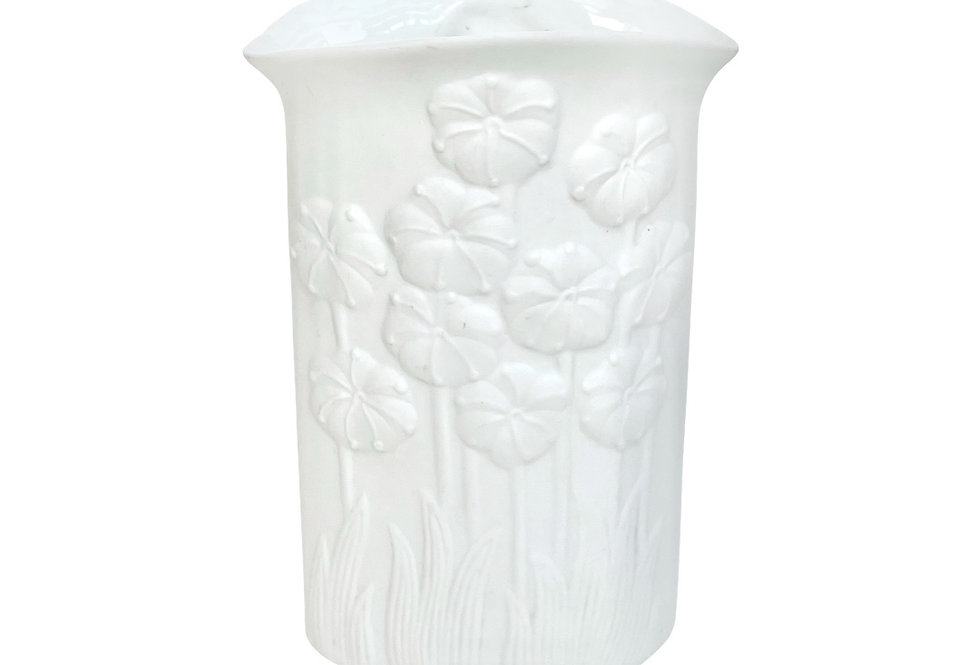 A pure white porcelin vase to be potted with succulents
