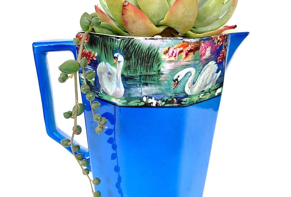 Stunning blue vintage vase with succulents