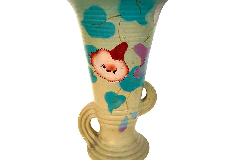 A beautifully painted tall vintage vase to be potted with succulents