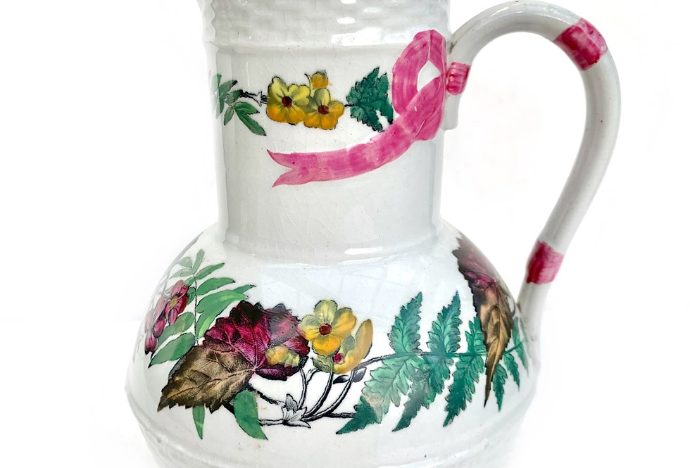 An unusual vintage jug with floral and pink ribbon design