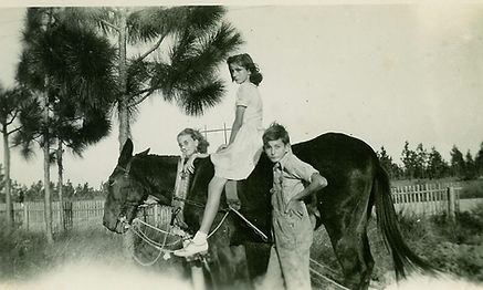 1. Jim Kelly with 2 sisters and the mule