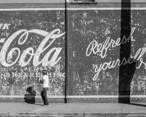 Girl and Coca Cola Sign DT Greenville SC