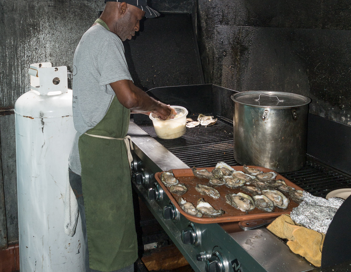Perry at Casamentos Charbroiling Oysters