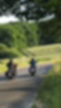 Two people riding Motorcycle in rural France