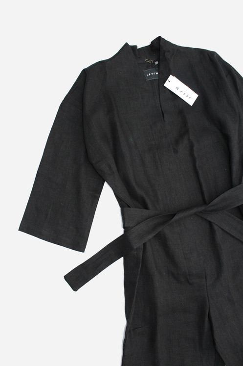 f76531c4a4 Long sleeve kimono style linen jumpsuit in Black. Side seam pockets.  Tapered and cropped legs. V Neckline with collar or collarless look.  Detached Tie Belt.