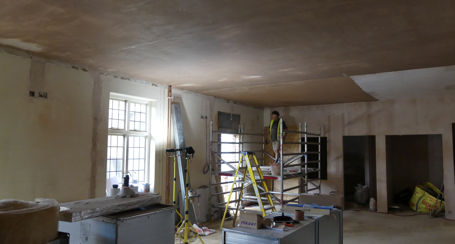 New hall being plastered, looking towards the back