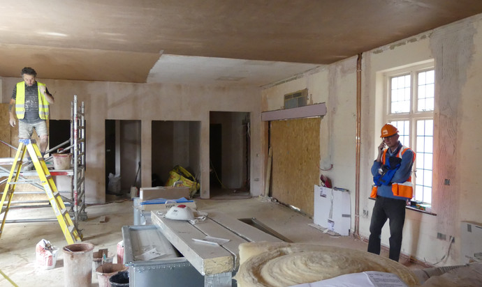 New hall showing kitchen, toilets and exit to outside play area