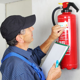 A Professional checking aFire extinguish