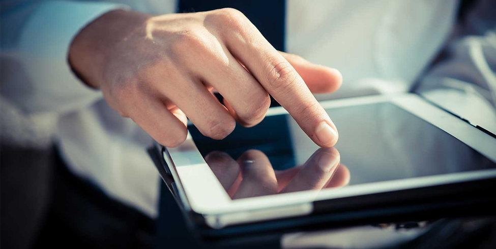 hand on tablet.jpg