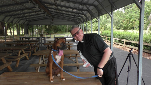 "Parish Puppy ""Buddy"" & Fr. Marek"