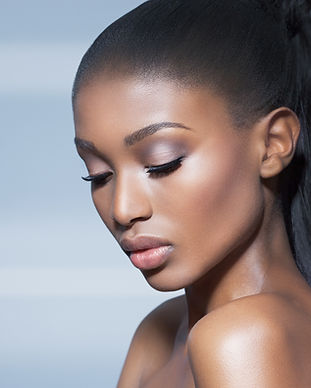 Beautiful African model over blue backgr