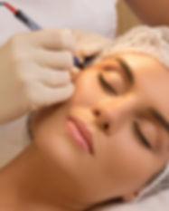 Beautiful woman in cosmetology salon dur