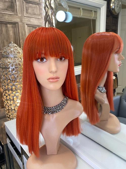 Neon burnt orange fibre wig