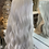 Thumbnail: Silver wavy fibre wig with fringe
