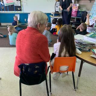 Grandma Nancy reads to a student.jpg