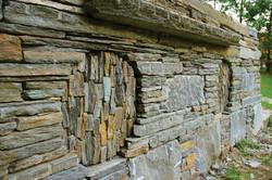 Hector Santos stone wall