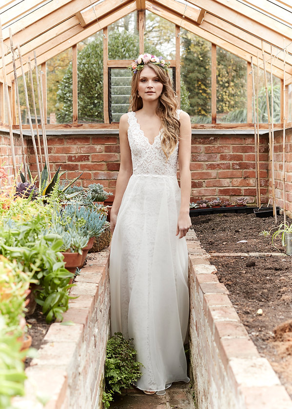 A stunning lace mermaid style with a scalloped lace bodice, v neckline, fitted lace mermaid skirt, full organza over skirt and finished with a v back.