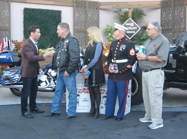 Eric Kahnert of CBS8 interviewing the group