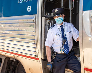 Train conductor with mask