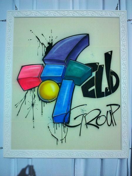 ציור גרפיטי ממותג לאירוע של חברת אלדן