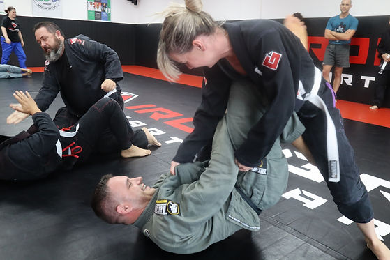 Man and Women training Brazilian Jiu Jitsu