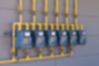 Row of residential natural gas meters an