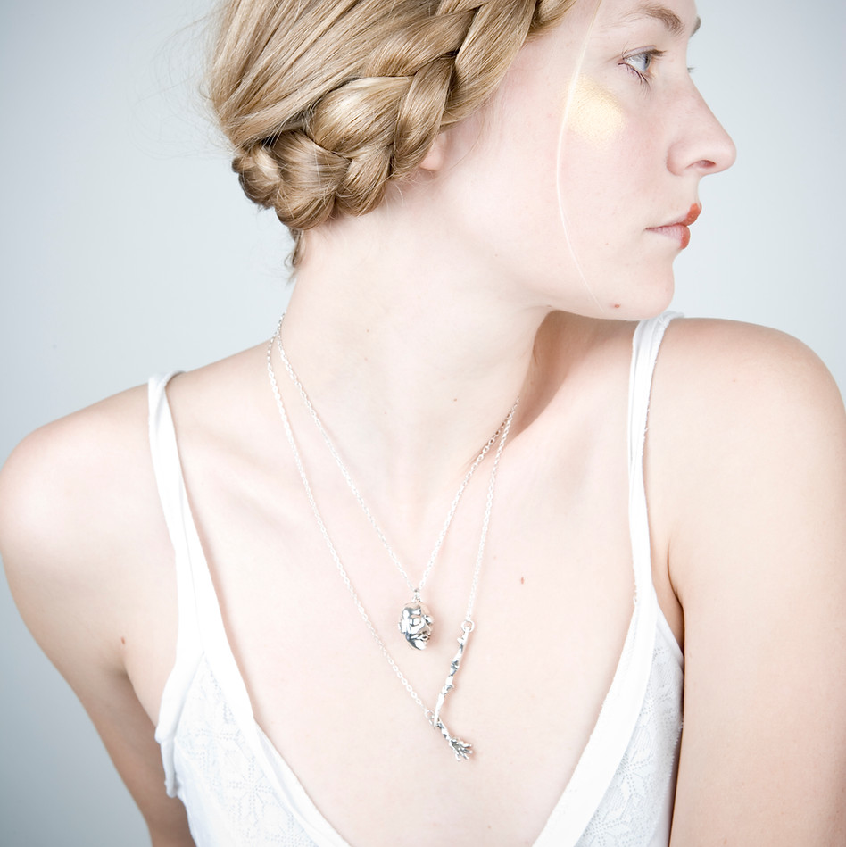 Silver limb necklaces on Erika 2008