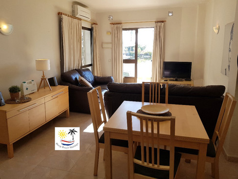 Capistrano Playa 411 - Dining area and living room
