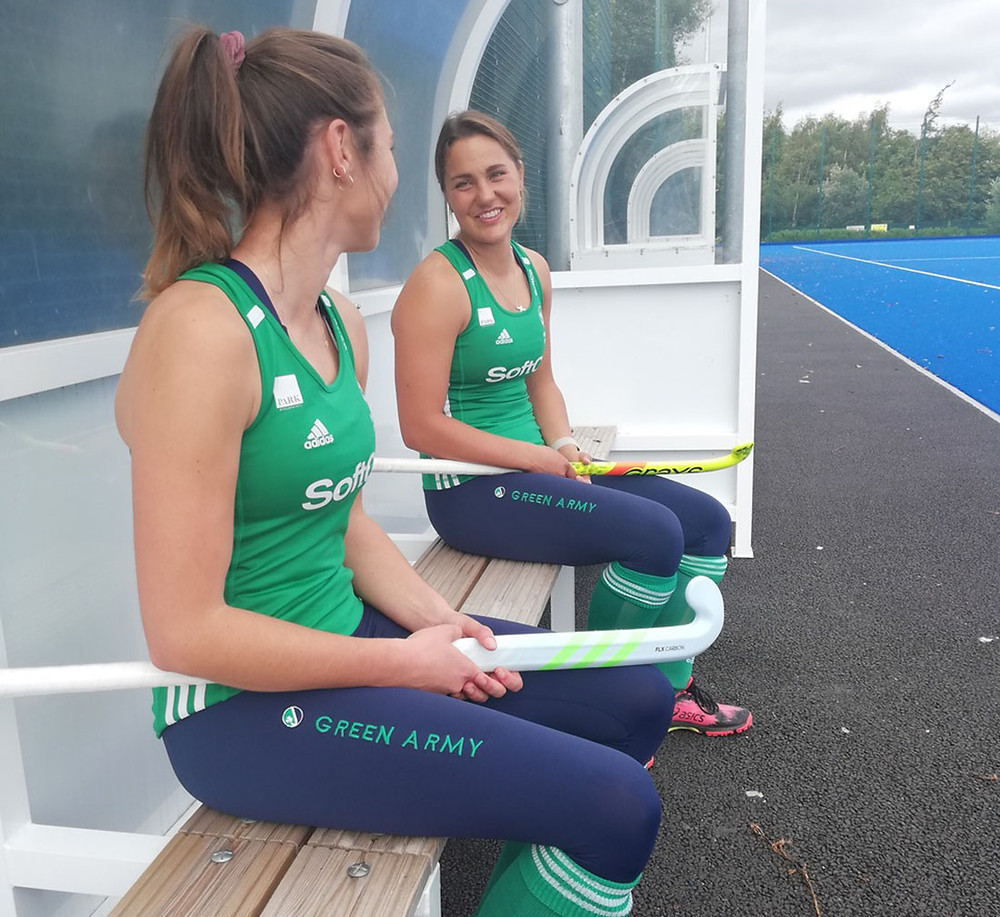 Deirdre Duke and Elena Tice of the Irish Hockey team, wearing Queen B Athletics clothing.