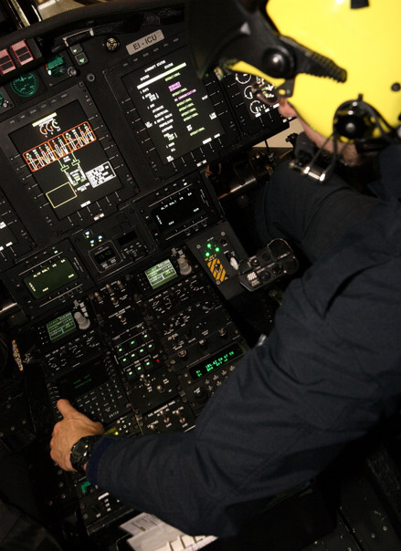 The pilot making pre flight checks