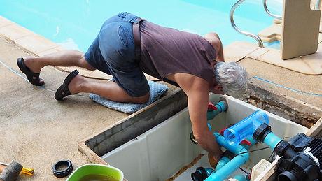 Technician fixing swimming pool water pu